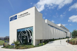The John Lennon Art and Design Building with Lennon logo; formerly the Art and Design Academy