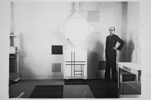 Mondrian in his Paris studio in 1933 with Lozenge Composition with Four Yellow Lines, 1933 and Composition with Double Lines and Yellow, 1933. Photo by Charles Karsten.