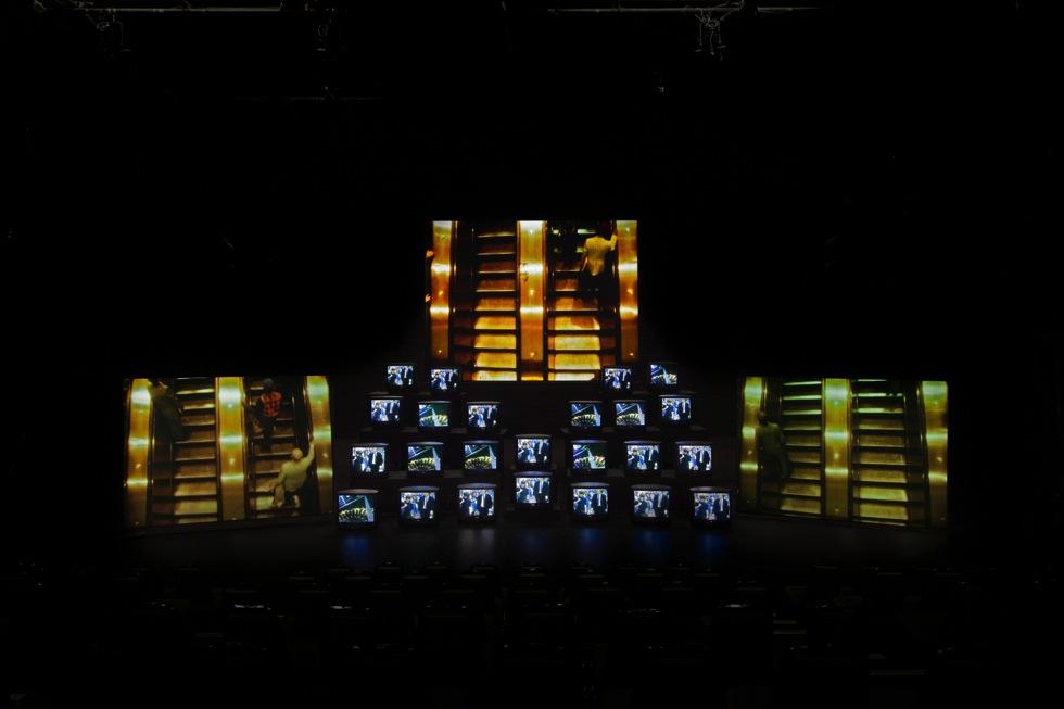 Gretchen Bender, 1951-2004, Total Recall 1987, 8-channel video installation; 24 monitors, 3 screen projections, colour, sound duration: 18min © Estate of Gretchen Bender. Photo: Jason Mandella, Courtesy of The Kitchen, New York