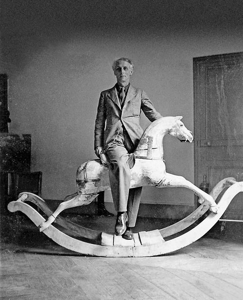 Max Ernst on rocking chair in Paris