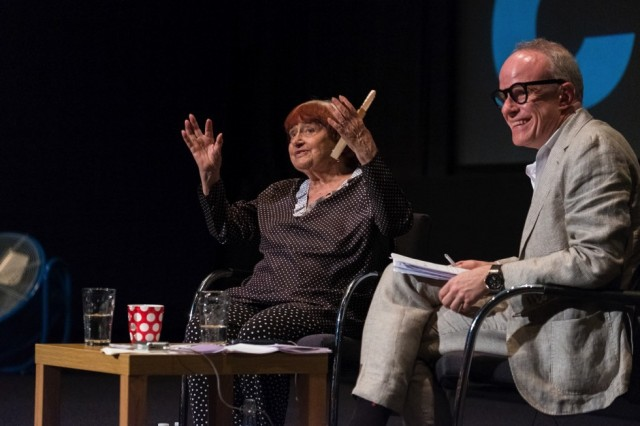 Agnès  Varda  in  conversation  with  Hans  Ulrich  Obrist  at  FACT  Liverpool,  Liverpool  Biennial  2018,  13  July  2018.  Photo:  Mark  McNulty