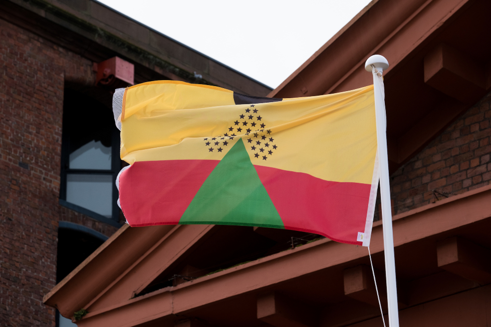 Larry Achiampong, Pan African Flag for the Relic Travellers' Alliance, 2021. Installation view at Dr Martin Luther King Jr. building, Liverpool Biennial 2021. Photography_ Mark McNulty-web